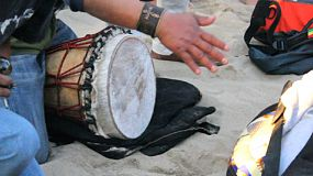A young man plays his djembe in the  drum circle on Venice Beach in beautiful Los Angeles, California.