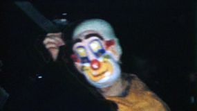 A man wearing a crazy scary clown costume for Halloween in the fall of 1957.