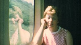A cute little blond haired boy and his mom riding on the train in the summer of 1967.