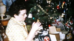 Mom gets a brand new iron and mixer for Christmas in Cleveland, Ohio in 1956.