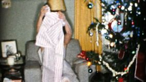 A mother gets a new nightgown and slippers on Christmas Day in 1956.