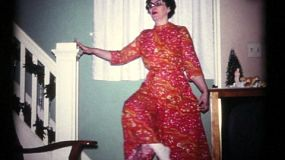 A wife models the new outfit that she made on her own in the Fall of 1972.