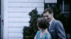 A proud mother dotes on her handsome soon to be a groom son prior to the big wedding in the summer of 1962.