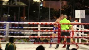 A Muay Thai kick boxing fighter gets taken down during a fight in Bangkok, Thailand.
