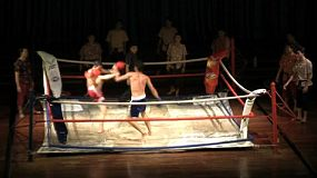 A shot of a couple of Thai kick boxers fighting each other on stage in an outdoor performance in Pattaya, Thailand.