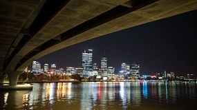 Time lapse of the lights of the Perth city skyline and the Swan River as seen from under the Narrows Bridge.