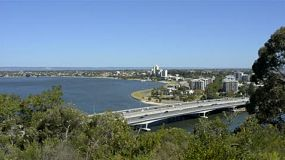 View of the Narrows Bridge from King's Park, in Perth Australia. Traffic and a train crossing the bridge on Kwinana Fwy on a clear summers day.