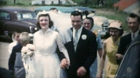 A happy newly married bride and groom arrive at their wedding reception in 1967.