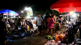 People Shopping in a Busy Night Market in Bangkok, Thailand.