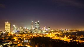 Night time lapse of Perth City CBD, Australia as seen from King's Park, with the lights from the freeway and the darkness of the sky above.