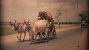 VARANASI, INDIA, JUNE, 1957: Tourists enjoy seeing old Ox carts in rural India in the summer of 1957.