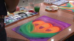 People doing art therapy, which is a form of expressive therapy that uses art materials, such as paints, chalk and markers. It is based on the idea that art is a means of symbolic communication.