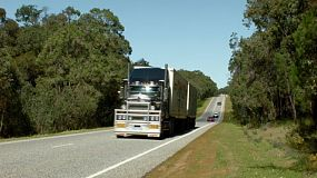 A road train travelling down a highway in country Australia.