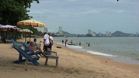 A typical shot of some tourists hanging around enjoying themselves on the beach in Pattaya, Thailand.