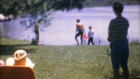 A peaceful scene of a family enjoying time together during their vacation in the summer of 1967.