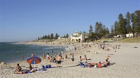 Cottesloe Beach in Perth, Western Australia, on a hot summer day, with many people enjoying the popular beach to escape the heat.