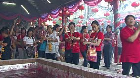 People prepare their incense and flowers during Chinese New Year – often called Chinese Lunar New Year which is the most important of the traditional Chinese holidays.
