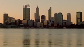 Perth city skyline and the Swan River at dusk.