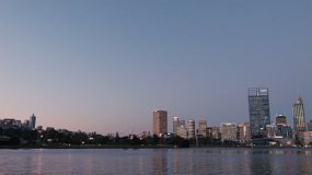 View of the West side of the City of Perth from across the Swan River, in the dusk light of the evening.
