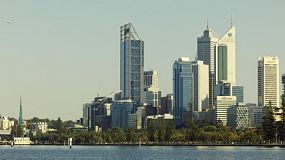 View of the City of Perth from across the Swan River, lit by the morning light.