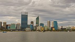 Time lapse of the City of Perth, Australia, with a view of the Swan River under cloudy skies.