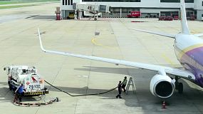 Workers refueling a plane at Don Muang Airport, Bangkok, Thailand.
