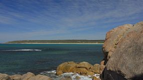 Rocks at Bunker Bay, near Dunsborough, Western Australia, with a view across the bay in the background. Tracking shot.