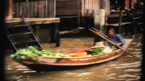 Scenic views from a boat ride exploring the famous Damnoen Saduak Floating Market in Bangkok, Thailand in 1967.