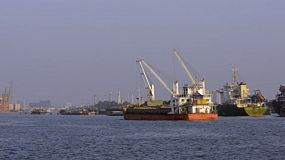 A ship traveling through the Khlong Toei Port in Bangkok, Thailand.