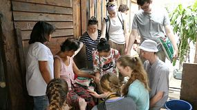 A group of high school students on an overseas missions trip pray for people in the slums of Bangkok, Thailand.