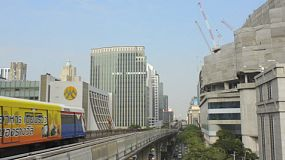 BANGKOK, THAILAND - OCTOBER 9 2013: The BTS skytrain running past skyscrapers and buildings in Bangkok, Thailand.