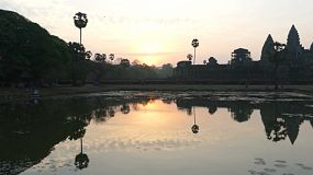 A beautiful shot of the sun rising over the famous Angkor Wat in Siem Reap, Cambodia.
