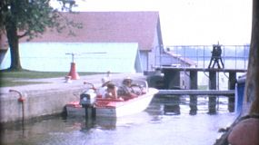 A speed boat waits to go through a lock and out into a larger waterway while on family holidays in the summer of 1967.