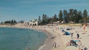 A hot day at Cottesloe Beach in Western Australia, with many people swimming, sunbathing and enjoying the beautiful weather.