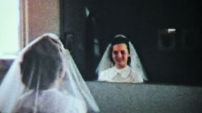 A pretty teenage girl prepares herself for her first ever communion at the Christian church in 1958.