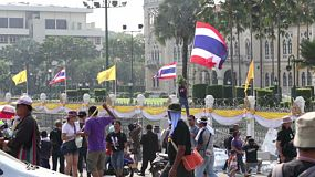 Protesters gather together at Government House in Bangkok, Thailand to give support to their political party.