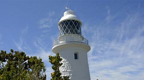 The cape naturaliste lighthouse set against light clouds and blue sky, in the leeuwin-naturaliste national park, in the south west of western australia. tracking shot.