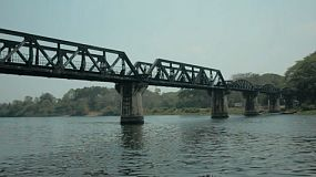 View of the famous bridge over the River Kwai in Kanchanaburi, Thailand.