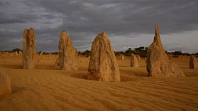 The Pinnacles at sunset, with storm clouds brewing in the sky. The Pinnacles are limestone formations contained within Nambung National Park, near the town of Cervantes, Western Australia.