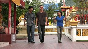 Three friends spend some quality time together as they head to the Buddhist temple in Bangkok, Thailand.