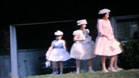 Three pretty sisters model their new Easter dresses in front of their home in the suburbs in 1964.