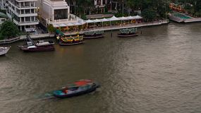 Timelapse of boats going up and down the Chao Phraya River in Bangkok, Thailand.