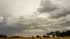 Time lapse of storm clouds brewing over an Australian summer landscape.