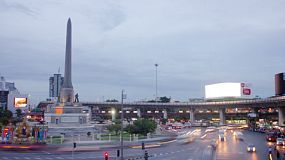 BANGKOK, THAILAND - NOVEMBER 8, 2013: Time lapse of Victory Monument at dusk, in Bangkok, Thailand, with the BTS skytrain and traffic circling the roundabout. 4k & 1080p.