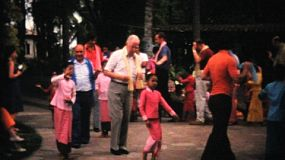 Tourist dancing with adorable Thai children after a special cultural show in Bangkok, Thailand in 1967.