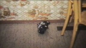 Playing with some cool toy cars from the 70's on the kitchen floor.