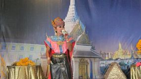A traditional Thai dancer sings and dances during a performance in Bangkok, Thailand.