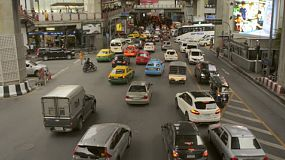 BANGKOK, THAILAND - NOVEMBER, 2013: Busy intersection by the Siam skytrain station during rush hour, in Bangkok, Thailand.