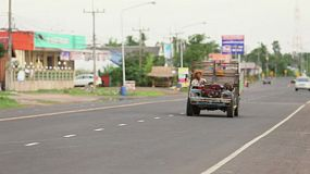 A crazy tripped out pick up truck zooms down the highway in the rural province of Buriram, Thailand.