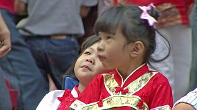Two cute little Asian girls all dressed up during Chinese New Year – often called Chinese Lunar New Year which is the most important of the traditional Chinese holidays.